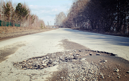 pit fall: Large pit on the suburban road