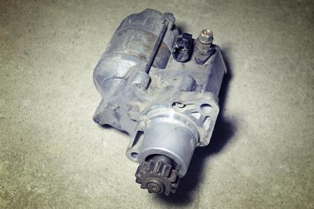 starter: Automotive starter on a gray background Stock Photo