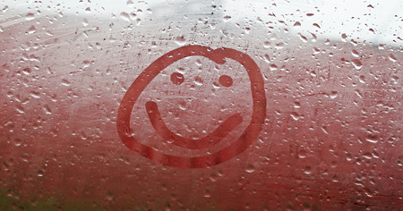 damp: Smile on the misted window