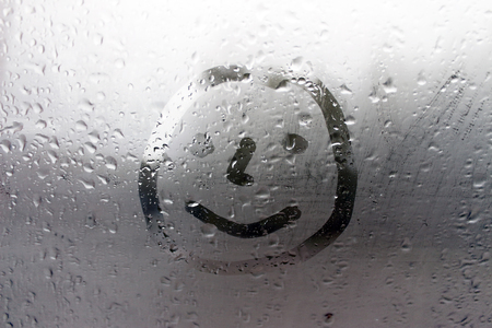 Smile on the misted window