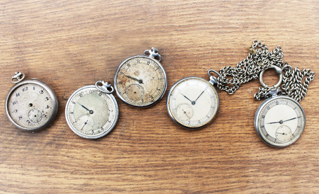 pocket watch: Old pocket watch on a wooden background