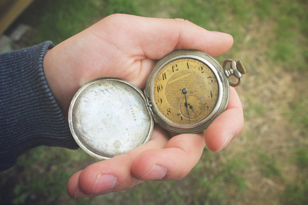 hand in pocket: Old pocket watch in a mans hand Stock Photo