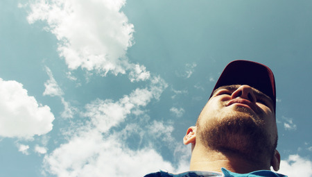the view from below: The man on the sky background - view from below
