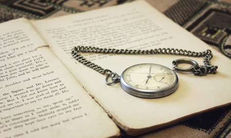 pocket watch: Old pocket watch on the book Stock Photo