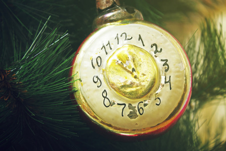 12 month old: Toy clock on the Christmas tree Stock Photo
