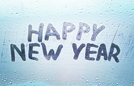misted: The inscription happy new year on the misted window
