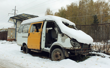 disassembled: Disassembled car after the accident under the snow