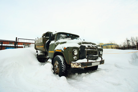 Abandoned old rusty truck in the winter Stock Photo