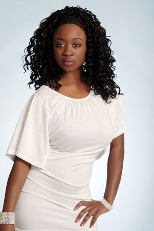 Sexy young jamaican woman wearing a white dress photo