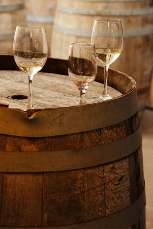 wooden barrel: Wine glasses on an old wine barrel