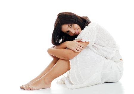 Jonge vrouw leunend op haar knieën Stockfoto