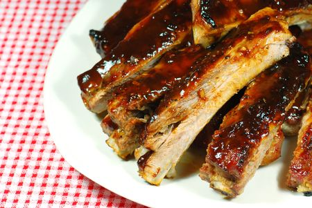 Barbecue Spare Ribs on a plate with a checkered tablecloth Stock Photo