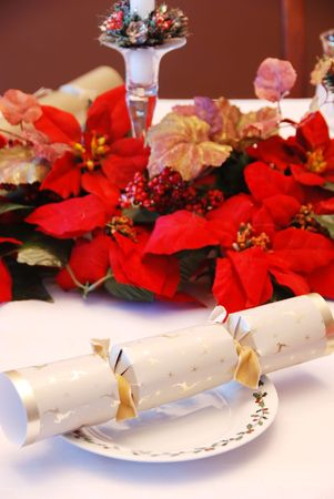Christmas party cracker on a decorated table photo