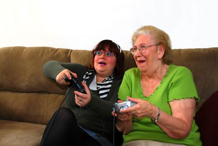 Granddaughter and Grandmother Playing Video Games photo
