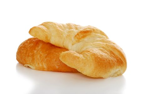 crescent: 2 crescent rolls isolated with shallow DOF
