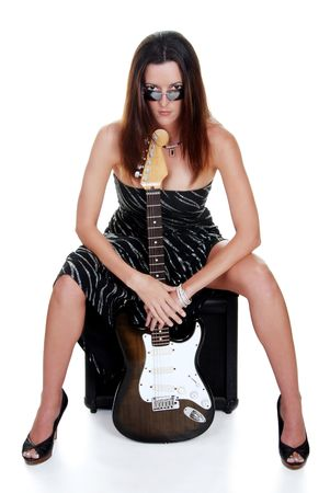 attractive brunette holding a guitar photo