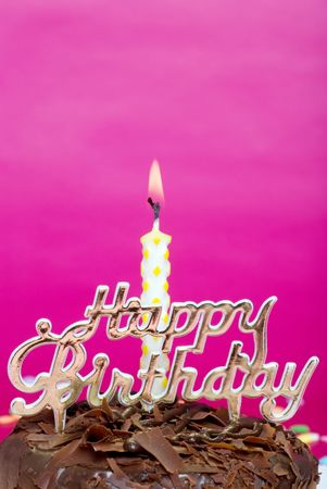 birthday cake with candle and sign close up photo