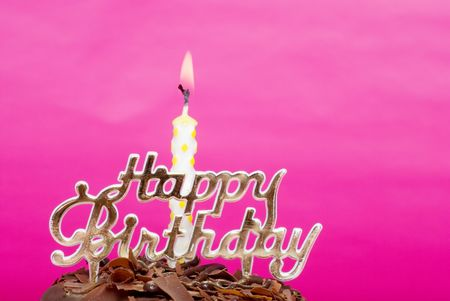 Birthday candle with sign photo