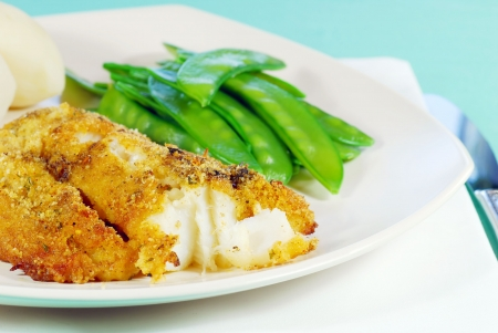 Fresh Cod with snow peas and potatoes photo