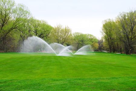 sprinklers: Watering the fairway of a golf course