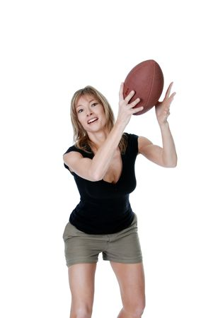 Woman catching a football isolated photo