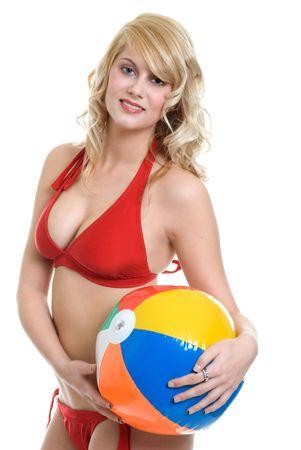blond woman wearing red bikini holding beach ball photo