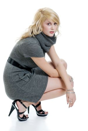 blond woman with grey dress squatting photo