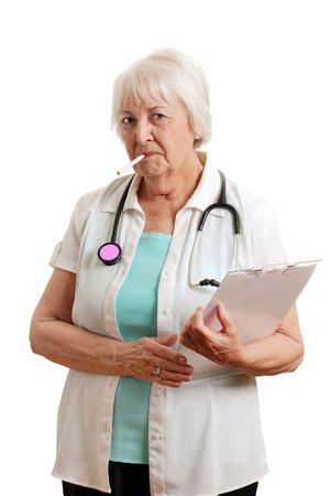 bad habits: Isolated Senior doctor with a cigarette in her mouth on a white background
