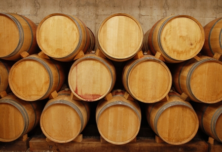 barrels of wine in storage photo