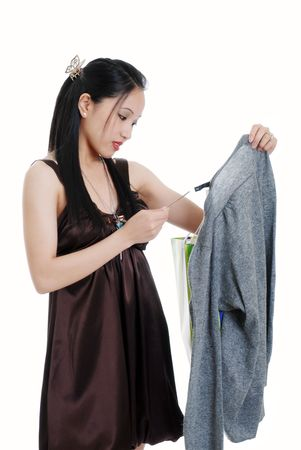 young woman checking a sales tag photo