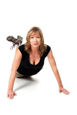 middle aged female doing push ups photo