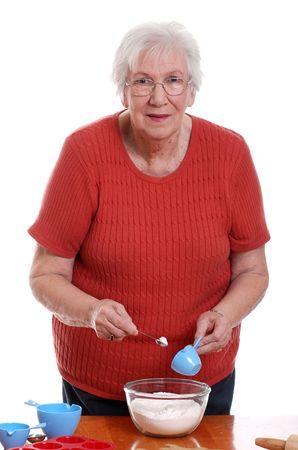 senior woman measuring while baking Stock Photo - 5486143