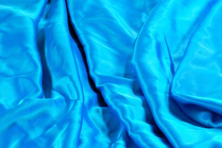material: Blue satin material making an interesting background