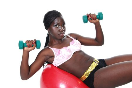 young female working out with weights and a ball photo