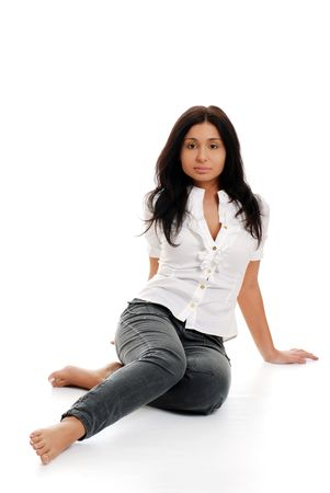 indian style sitting: Young hispanic woman posing