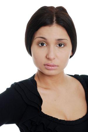 young hispanic woman sad with a tear photo