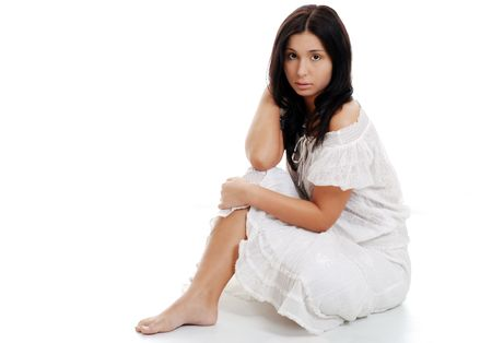 Young hispanic woman sitting with legs crossed