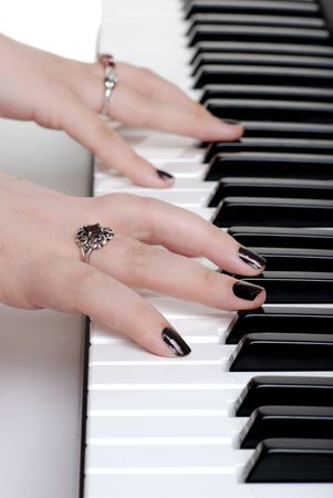 closeup hands playing a piano Stock Photo