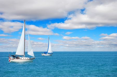 sail boating on blue water photo