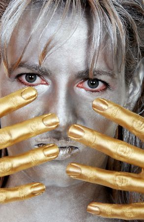 closeup headshot silver woman with gold fingers photo