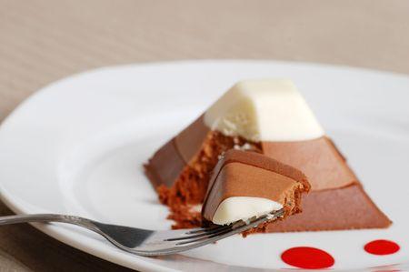 Chocolate pyramid cake with slice on fork photo