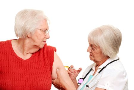 Senior doctor giving an elderly patient her injection Stock Photo - 5583060