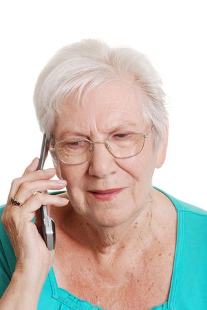 Senior woman talking on a cell phone photo