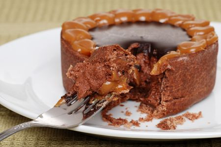 chocolaty: chocolate toffee caramel cake on a fork Stock Photo