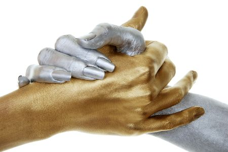 communication metaphor: closeup of gold and silver hands