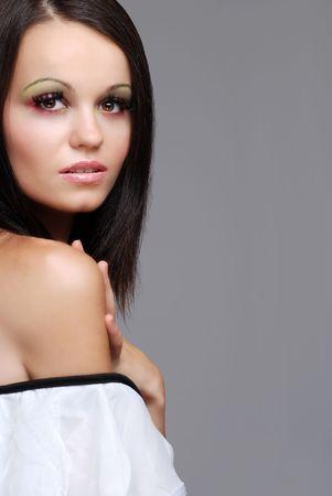 european brunette woman wearing a white top photo