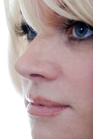 extreme close up blond woman with blue eyes photo