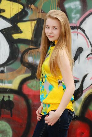 attitude girls: female teenager with graffiti background