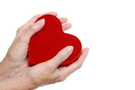 elderly woman hands holding a heart Stock Photo - 5675474