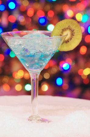 Ice christmas drink with a slice of kiwi photo